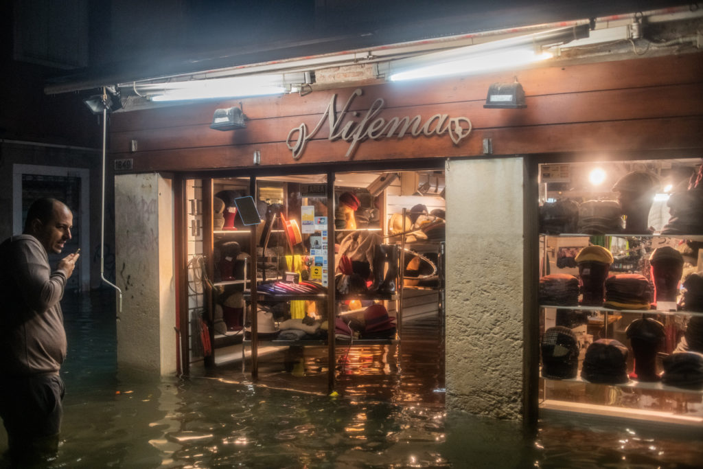 Damage can be seen inside a shop during an exceptional high tide on November 13, 2019 in Venice, Italy. Photo by Simone Padovani/Awakening/Getty Images.