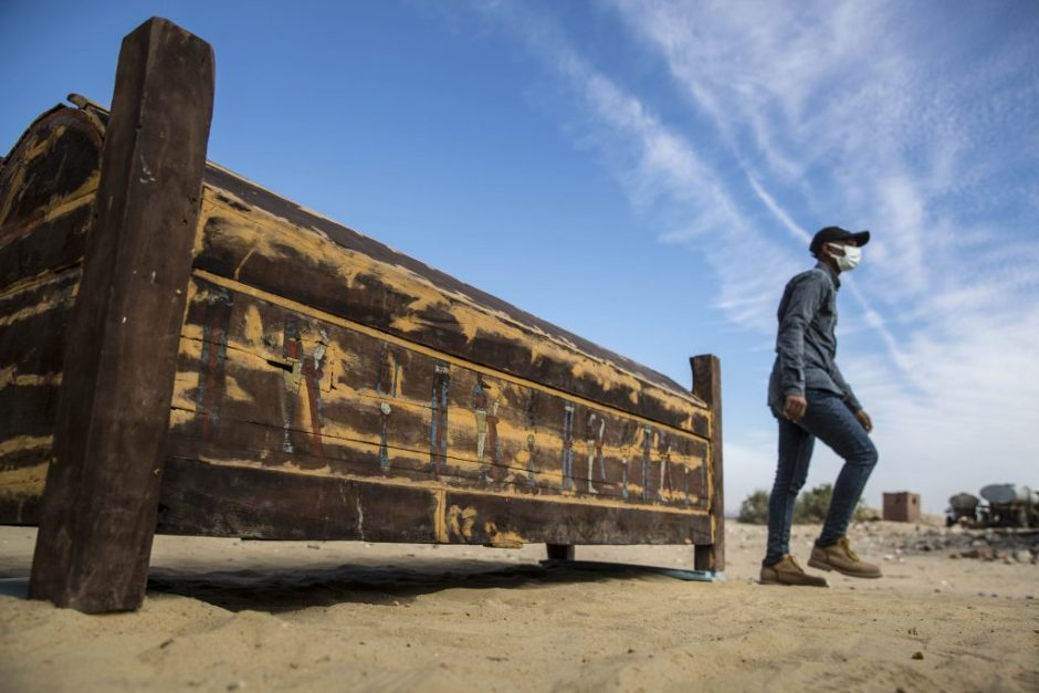 An adorned wooden sarcophagus is displayed during the official announcement of the discovery. (Photo by KHALED DESOUKI/AFP via Getty Images)
