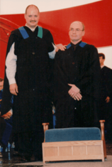 Registrar and Jim Little in covocation gowns in 2003