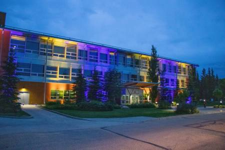 Photo of ARC building aglow with orange and blue lights