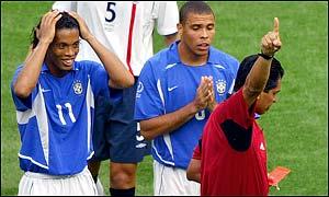 Ronaldinho cannot believe referee Felipe Ramos Rizo has shown him the red card