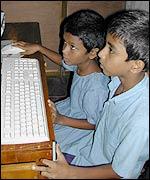 children using computer in Brac school