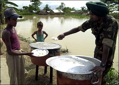 Indian Army soldiers giving out food to flood victims
