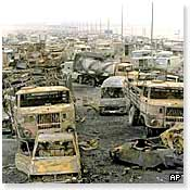Bombed out vehicles on the Basra road