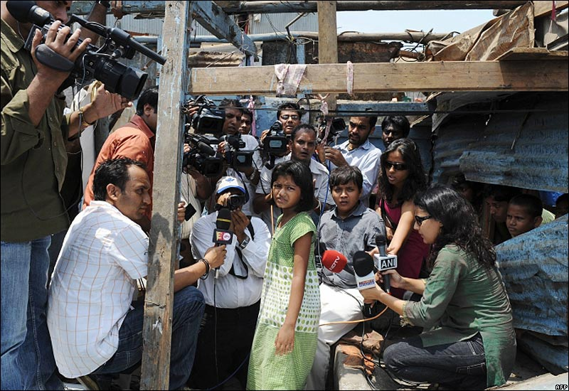 BBC News: Rubina Ali, star of the Oscar-winning film Slumdog Millionaire, speaks with the media in front of her demolished shanty in Mumbai. Neighbours say that the stars father was injured in a scuffle as the slum was being torn down.