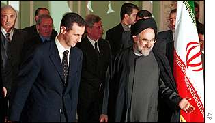 Syrian President Bashar al-Assad (left) with Iranian President Mohammad Khatami