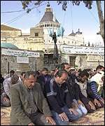 muslims sit-in in front of the Basilica of The Annunciation