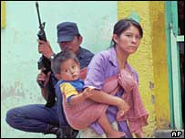 Indigenous Indian woman and military police officer in a Chiapas village