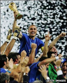 The Italian players celebrate as Fabio Cannavaro of Italy lifts the World Cup trophy aloft following victory in a penalty shootout at the end of the Fifa World Cup Germany 2006 Final