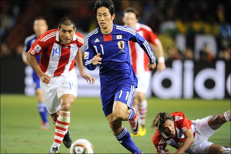 Keiji Tamada runs with the ball