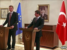 Turkey's Foreign Minister Ahmet Davutoglu (right) and EU  Enlargement Commissioner Stefan Fule in Ankara, 15 Mar 10