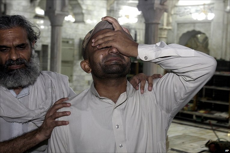 Shocked relative at shrine in Lahore