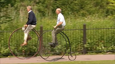 Men riding the penny farthing