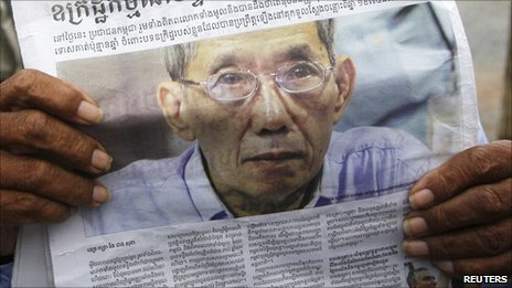 Newspaper showing a picture of jailed ex-prison chief Duch