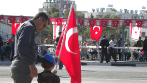A little boy holds a Turkish flag in Cyprus