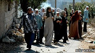 Women marching in Budrus