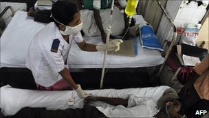 A patient receives malaria treatment in a hospital in Mumbai