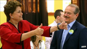 Dilma Rousseff (l) and candidate to Governor of Rio Grande do Sul state, Tarso Genro, after voting in Porto Alegre, Brazil, 31 October 2010