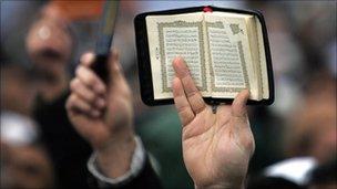 Koran held aloft (generic)