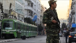 A Tunisian soldier patrols central Tunis,  16 January