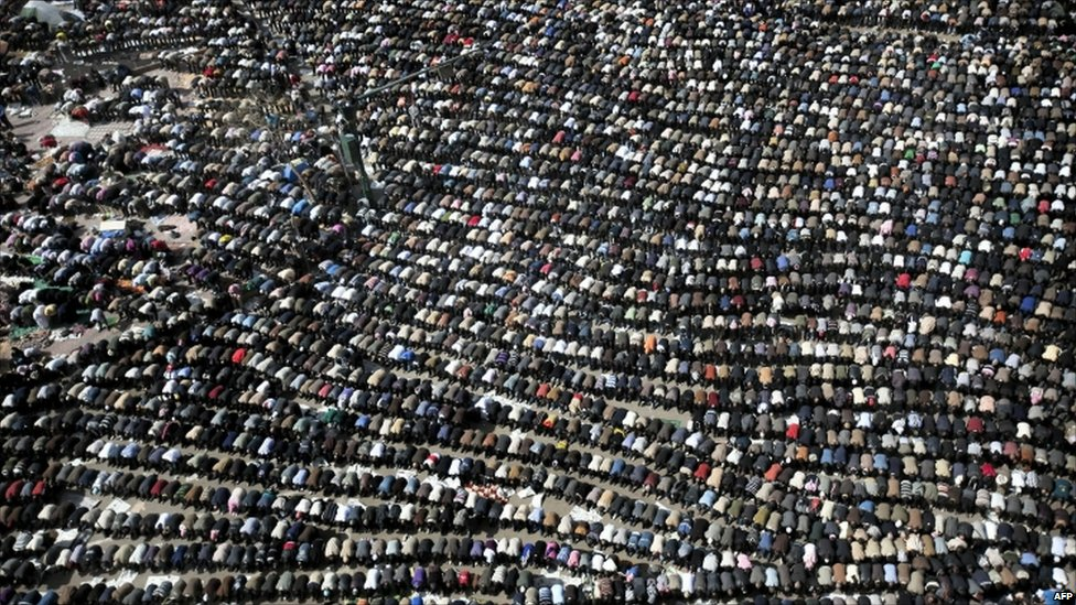 Anti-government protesters pray in Tahrir Square, Cairo - 4 February 2011
