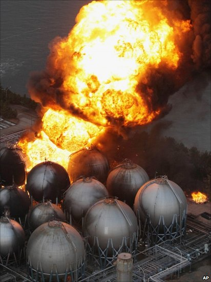 Giant fireballs rise from a burning oil refinery in Ichihara