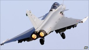 A French Air Force Rafale jet fighter takes off for a mission to Libya from Solenzara Air Base, on Corsica - 26 March 2011