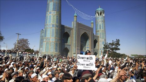 Afghans chant anti US slogans during a demonstration in Mazar-e- Sharif on Friday, April. 1, 2011