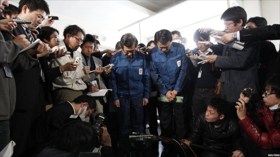 Tokyo Electric Power Co's president bows in front of the media in Fukushima on 11 April 2011