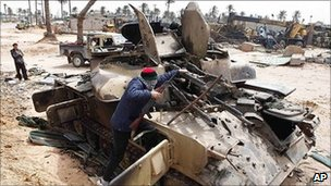 Rebel fighter with destroyed tank in Misrata. 22 April 2011