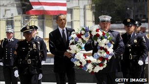 The US president carries a wreath during a ceremony at Ground Zero, in New York (5 May 2011)