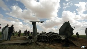 Libyans gather around the wreckage of a US F-15 Eagle fighter jet