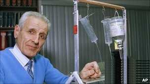 "Jack Kevorkian standing with his ""mercy machine"""