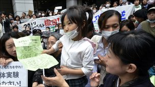 A girl holds her petition to ask the education ministry to protect children from radioactive contamination at Fukushima prefecture during a rally