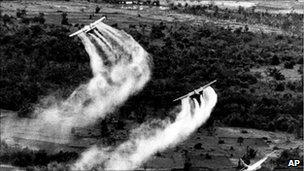 US Air Force planes spray Agent Orange over dense vegetation in South Vietnam, 1966