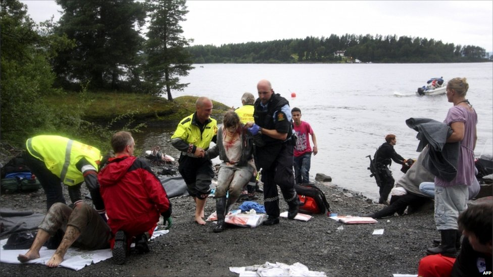 A wounded woman is brought ashore opposite Utoeya island, Norway