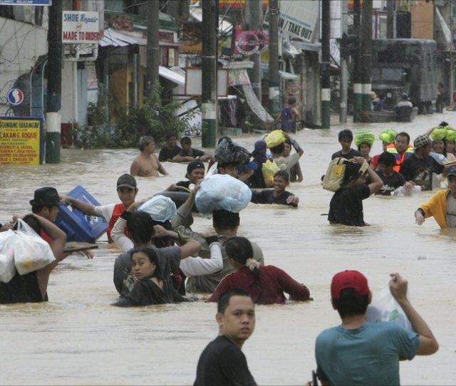 Residents Of Calumpit Township In Bulacan Province North Of The Philippine Capital Manila Wade