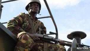 A Kenyan soldier keeps watch at the Garrisa airstrip near the Somali-Kenyan border 18 October 2011