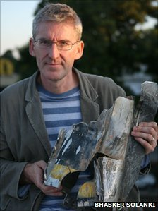 Clive Stafford Smith, director of the British legal charity Reprieve, holding the fragment of a missile