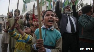 Young supporters of Jamaat-e-Islami, a religious and political party, yell anti-American slogans while protesting in Islamabad