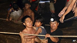 Residents are rescued from floods in Cagayan de Oro City, Philippines. 17 Dec 2011