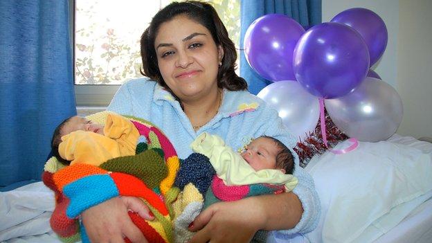 Roula Bandaq with twin girls