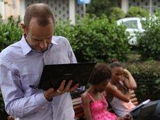 Evan makes use of a free wifi hotspot in Praia