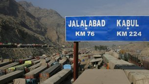 A road sign, photographed from atop gridlocked trucks, shows the distance to cities in Afghanistan after traffic was halted at the Pakistani border town Torkham November 27, 2011