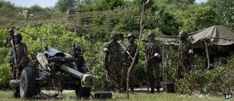 Kenyan army soldiers are seen in their base near the seaside town of Bur Garbo, Somalia Wednesday, Dec. 14, 2011.