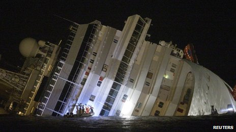The luxury cruise ship Costa Concordia lies on its side after running Giglio island, Italy, 14 January