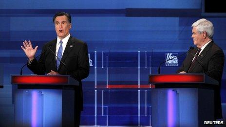 Republican presidential candidate former Massachusetts Governor Mitt Romney speaks as former House Speaker Newt Gingrich