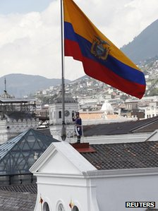 Ecuadorean presidential guards rise the national flag during a special change of presidential guards ceremony marking President Rafael Correa's fifth year as president on 16 January