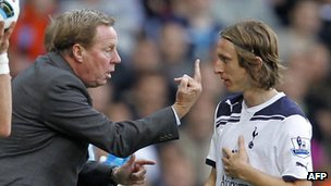 Tottenham manager Harry Redknapp gives the finger to his own player