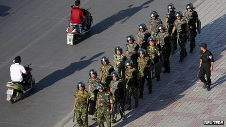 Armed police officers at a square in Kashgar, Xinjiang province (August 2011)